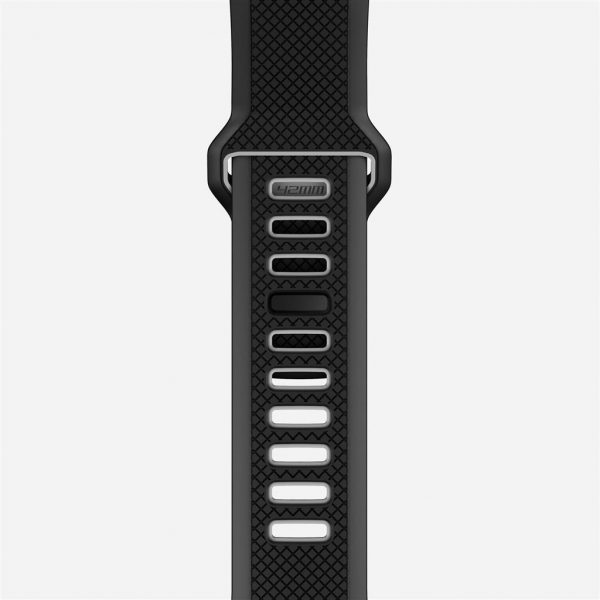 Nomad Apple Watch Sport strap - Slate - Black - Black The Nomad Sport Strap is molded entirely from durable LSR silicone, a naturally biocompatible, antimicrobial and hypoallergenic material, making for a smooth, safe and comfortable fit around your wrist. The strap's face spans the width of the watch itself, projecting a rugged yet sharp presence with its smooth chamfers and intricate crosshatch surface.