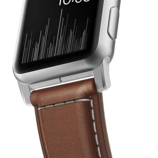 Leather Nomad Apple Watch strap – Traditional - Brown - Silver Designed to give your Apple Watch a classic, yet bold new look. Made from minimally treated, vegetable tanned leather from one of America's oldest tanneries.The leather is designed to beautifully patina with time, creating a handsome, rich leather strap with a look that is uniquely yours.  Horween leather from the USA  Fil Au Chinois beeswax linen thread  Custom stainless steel lugs and buckle  Designed for Apple Watch Series 5  Works with all previous versions of Apple Watch, including Apple Watch Series 3