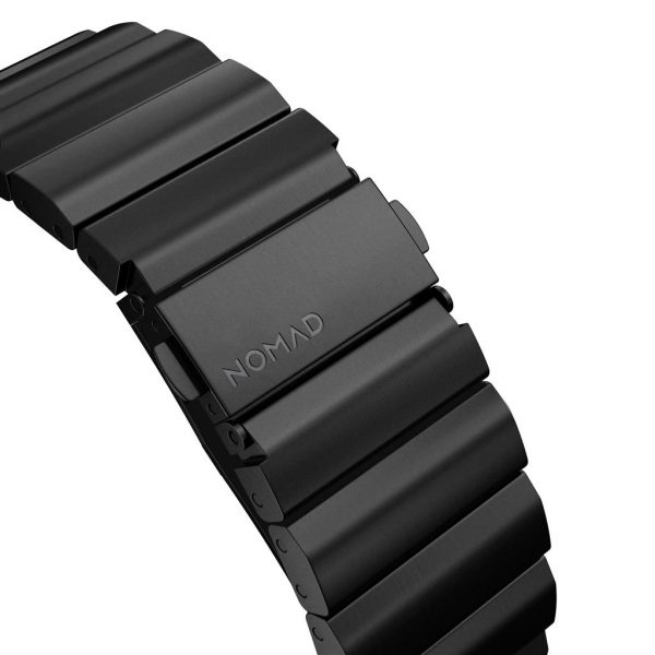 Nomad Apple Watch strap – Titanium – Black – Black Designed for Apple Watch, Titanium Band has been engineered to be as light as possible while giving you the confidence of a high-end metal link bracelet. Leveraging the qualities of high-grade titanium, this is our strongest strap to date. Built with our custom lugs, this lightweight and robust strap can withstand the roughest of conditions.  Titanium links and buckle  DLC (Diamond-Like Carbon) Scratch Resistance  Custom stainless steel lugs  Tool included to adjust length