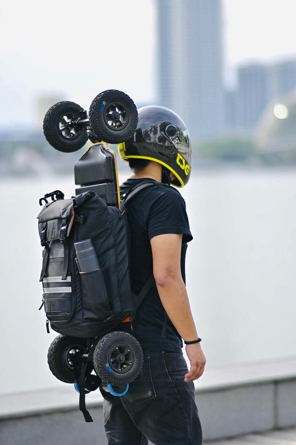 """ATSA Everyday® Skateboard Backpack The ATSA Everyday® Skateboard Backpack is designed to carry any kind of (electric) skateboard together with your everyday essentials.  Built with clever storage solutions for electric skateboard riders: remote controller, charger, shades, water bottle, camera tripod, fullface helmet, a change of fresh clothes/shoes and a strap for selfie sticks so you can film hands-free from a drone perspective. There is even a reinforced area for spare battery packs.  With a premium rubberish coating and waterproof zippers, it's perfect for all weather conditions. The matte black design simply looks great in every situation. Confidently carry the ATSA to both client meetings and weekend road trips. It's not just another bag, the Everyday® ESK8 backpack is made to last.   Premium rubberish fabric & magnetic clasp  Korean-made waterproof zippers  Strong enough for heavy boards  Extra protective padding for laptop up to 17""""  Clever storage solutions for accesories  Preorder: Arriving at our warehouse mid-december."""